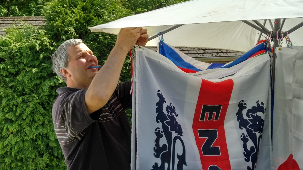 Alan putting up his flags